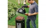 Man lifting lid on smoker